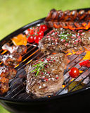 Delicious beef meat with vegetable on a barbecue grill. Royalty Free Stock Photography