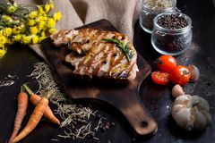 Delicious beef or pock steaks on wooden table. Grilled bbq steak stock images