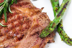 Delicious beef steak with grilled asparagus. Stock Photo
