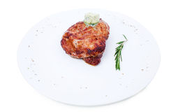 Delicious beef steak with herb butter. Delicious beef steak with herb butter and rosemary bunch. Isolated on a white background Stock Image