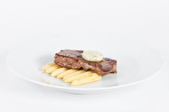 Delicious beef steak. On white plate with corn Royalty Free Stock Image