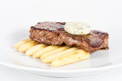 Delicious beef steak on white plate with corn. Delicious beef steak on white plate with baby corns Stock Images