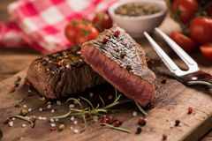 Delicious beef steak on wooden table royalty free stock photo