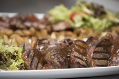 Delicious beef steak on wooden table, close-up Royalty Free Stock Photography
