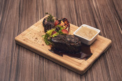 Delicious beef steak on wooden table, close-up. Stock Photography