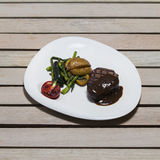Delicious beef steak on wooden table, close-up. Royalty Free Stock Photos