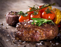 Delicious beef steaks Stock Photos