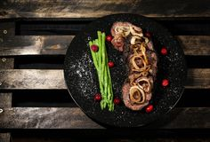 Delicious beefsteak with veggie's garnish royalty free stock photography