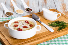 Delicious Beer and cream spicy Soup with Kielbasa Sausage Stock Photo