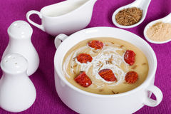 Delicious Beer and cream spicy Soup with Kielbasa Sausage sprinkled with cumin in white soup cup Royalty Free Stock Photography