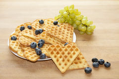 Delicious Belgian Waffles with Fruits. Delicious Belgian Waffles with Fresh Fruits Royalty Free Stock Images