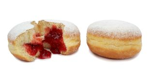 Delicious berliner with jam Stock Photos