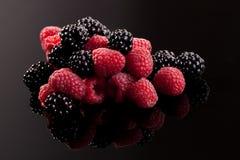 Delicious berries on black. Stock Photo