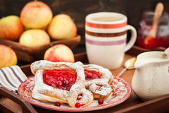 Delicious berry puff pastry with powdered sugar and coffee Royalty Free Stock Photos