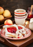 Delicious berry puff pastry with powdered sugar and coffee Royalty Free Stock Image