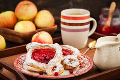 Delicious berry puff pastry with powdered sugar and coffee Royalty Free Stock Photo