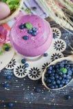 Delicious bilberry smoothie, detox yogurt or milkshake with fres Royalty Free Stock Photography