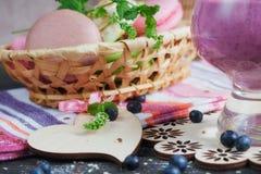 Delicious bilberry smoothie, detox yogurt or milkshake with fres Stock Images