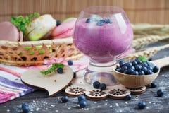 Delicious bilberry smoothie, detox yogurt or milkshake with fres Stock Photography