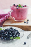 Delicious bilberry smoothie with fresh berries. Fresh yogurt wit Royalty Free Stock Photos
