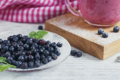 Delicious bilberry smoothie with fresh berries. Fresh yogurt wit Stock Image