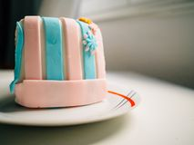 Delicious birthday cake decorated in blue and pink stock photography