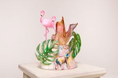 Delicious birthday cake topper with decoration flamingo leaves of sugar paper, cake for birthday and holiday.