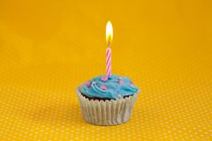 Delicious birthday cupcake with candles Royalty Free Stock Image