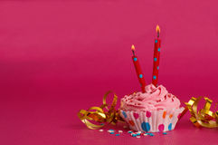 Delicious birthday cupcake on pink background Royalty Free Stock Images