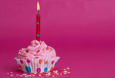 Delicious birthday cupcake on pink background Royalty Free Stock Photos