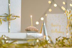 Delicious birthday cupcake with single candle on top Royalty Free Stock Photo