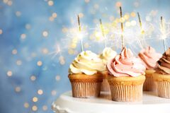 Free Delicious Birthday Cupcakes With Sparklers On Stand Against Blurred Background Stock Photos - 172131903