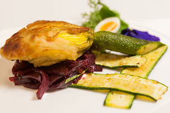 Delicious biscuit with beets, zucchini and pansy Royalty Free Stock Image