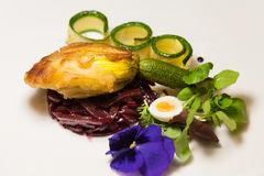 Delicious biscuit with beets, zucchini and pansy Royalty Free Stock Photo