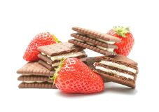 Delicious biscuits with cream and strawberry. On white Stock Photos