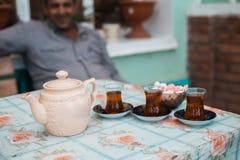 Delicious black Azerbaijani tea in a teapot and cups. Delicious black Azerbaijani tea in teapot and cups Royalty Free Stock Photography