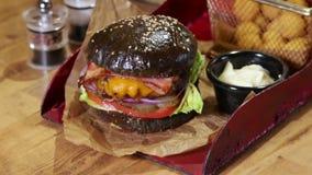Delicious black bread burger stock video footage