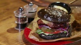Delicious black bread burger stock footage