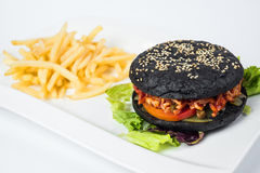 Delicious black hamburger and fries on white Stock Photo