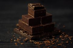 Delicious black and milk chocolate on a brown background Stock Photo
