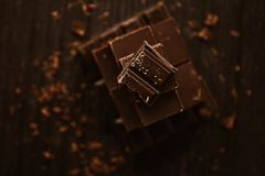 Delicious black and milk chocolate on a brown background Stock Images