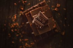 Delicious black and milk chocolate on a brown background Stock Photography