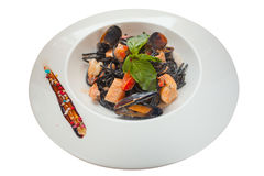 Delicious black spaghetti Neri with cream sauce and seafood Royalty Free Stock Image