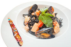 Delicious black spaghetti Neri with cream sauce and seafood Stock Image