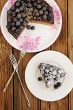 Delicious blackberry chocolate pie with cut piece and two forks Royalty Free Stock Photos