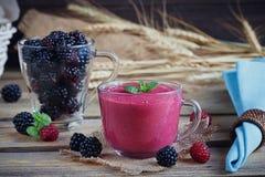 Delicious blackberry and raspberry smoothie, detox yogurt or mil Royalty Free Stock Photos