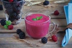 Delicious blackberry and raspberry smoothie, detox yogurt or mil Royalty Free Stock Photo