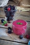 Delicious blackberry and raspberry smoothie, detox yogurt or mil Stock Photo