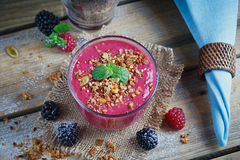 Delicious blackberry and raspberry smoothie, detox yogurt or mil Royalty Free Stock Photography