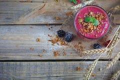 Delicious blackberry and raspberry smoothie, detox yogurt or mil Stock Image